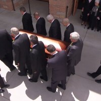 President Packer's casket is carried by pall bearers.